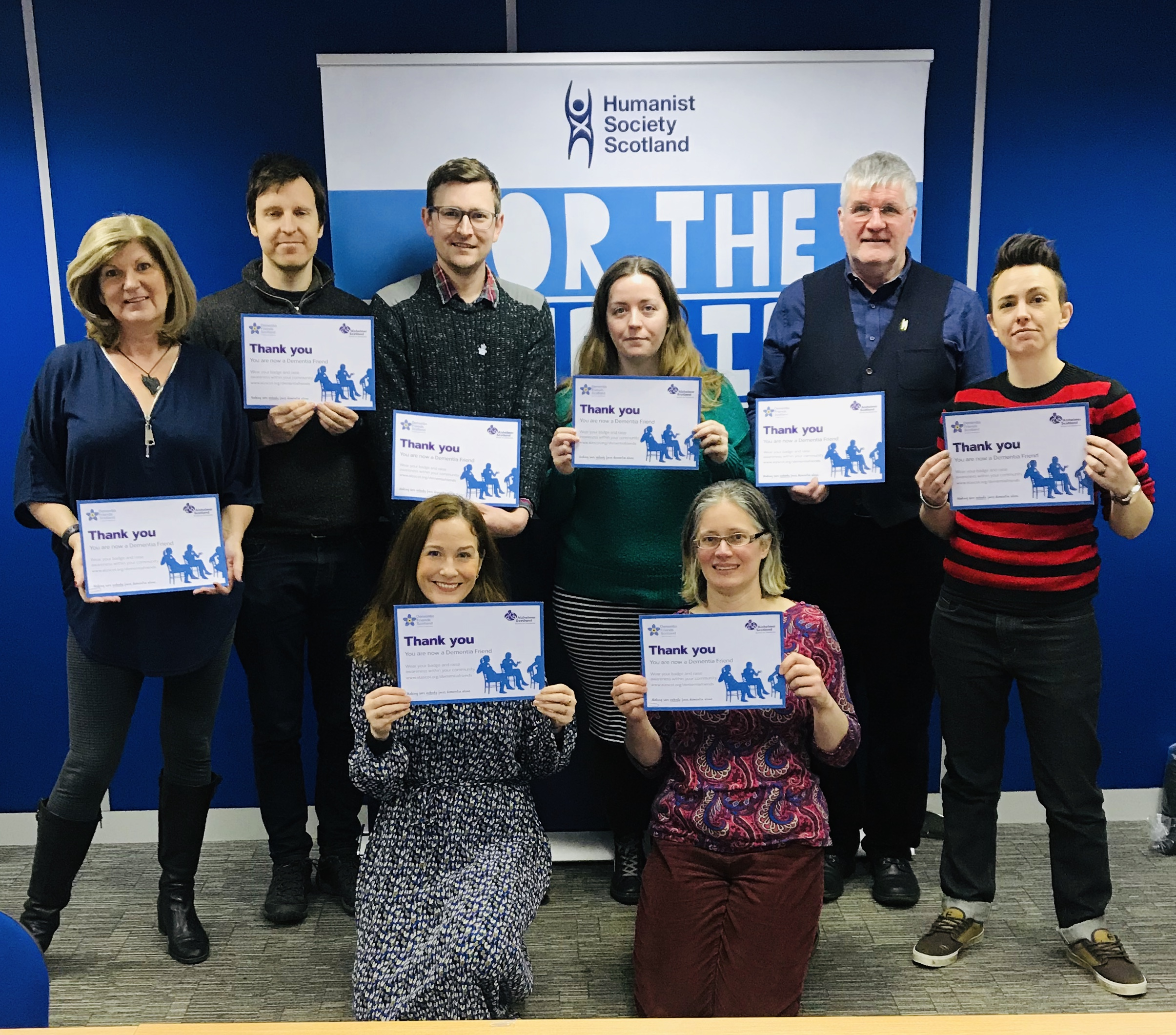 Staff team with their Dementia Friends certificates